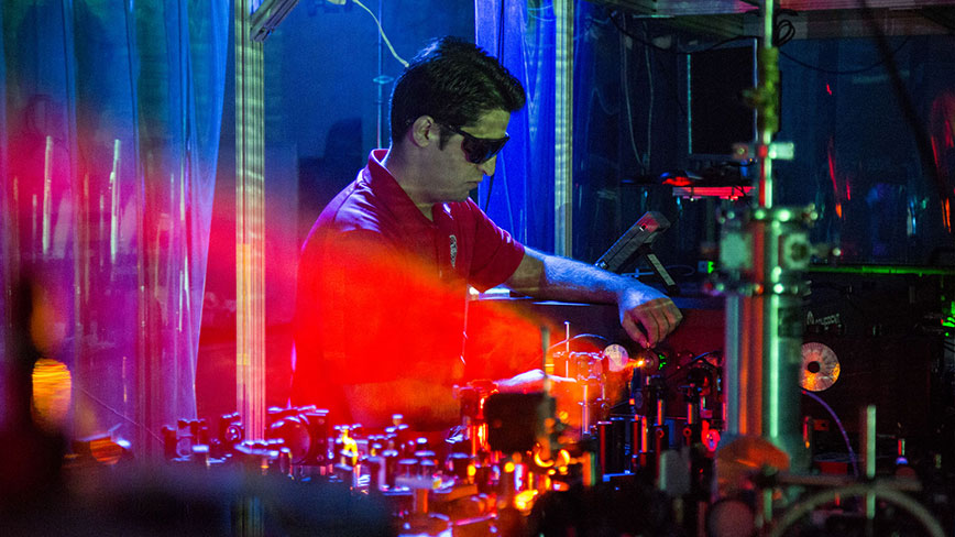 Aram Gragossian tests lasers in Sheik-Bahae lab at Physics & Astronomy building